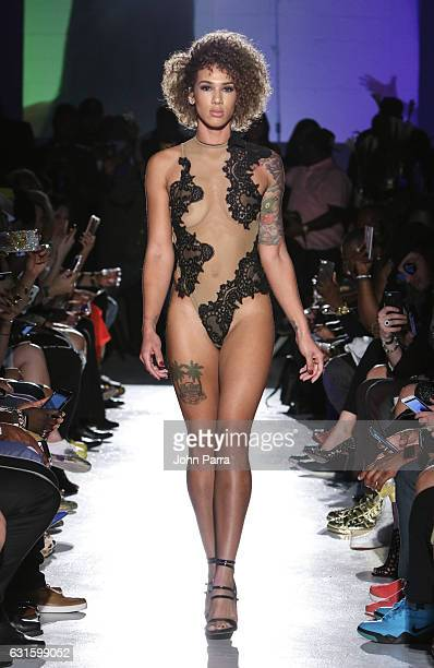 A model walks the runway during the launch of Designer Courtney Quinn's new couture lingerie line hosted by Eva Marcille on January 12 2017 in Miami...