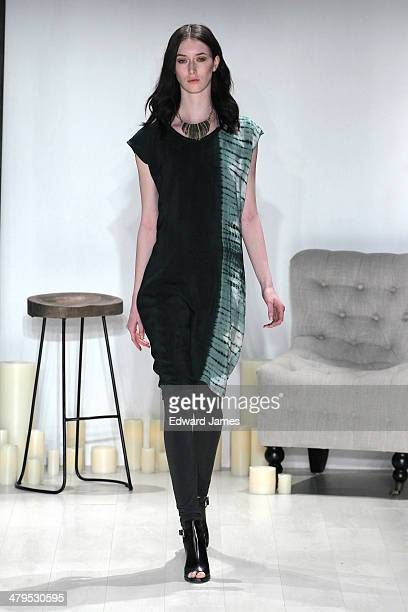 A model walks the runway during the Laura Seigel fashion show during World Mastercard fashion week on March 18 2014 in Toronto Canada