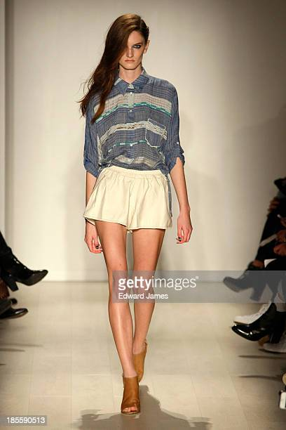 A model walks the runway during the Laura Siegel fashion show at David Pecaut Square on October 22 2013 in Toronto Canada