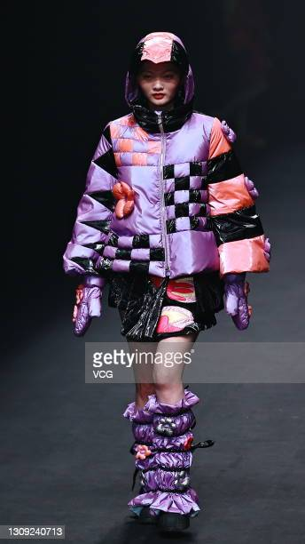 Model walks the runway during the Leaf Xia colorwonderland by Xia Yiqi & CALICO Collection by Luo Yuhao show on day two of China Fashion Week A/W...