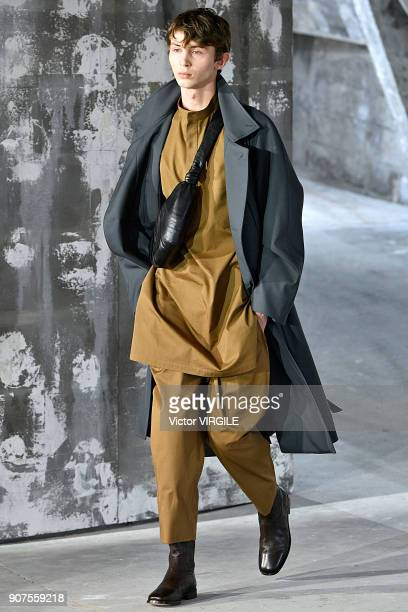 A model walks the runway during the Lemaire Menswear Fall/Winter 20182019 show as part of Paris Fashion Week on January 17 2018 in Paris France