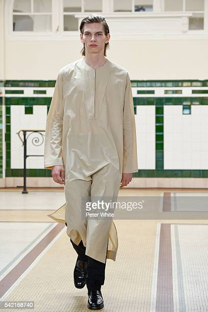 Model walks the runway during the Lemaire Menswear Spring/Summer 2017 show as part of Paris Fashion Week on June 22, 2016 in Paris, France.