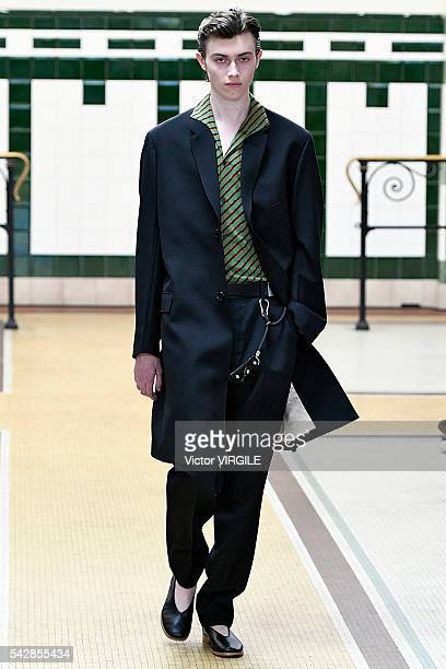 A model walks the runway during the Lemaire Menswear Spring/Summer 2017 show as part of Paris Fashion Week on June 22 2016 in Paris France