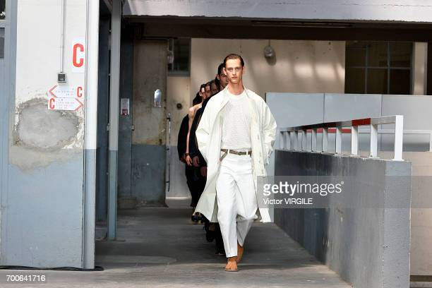 A model walks the runway during the Lemaire Menswear Spring/Summer 2018 show as part of Paris Fashion Week on June 21 2017 in Paris France