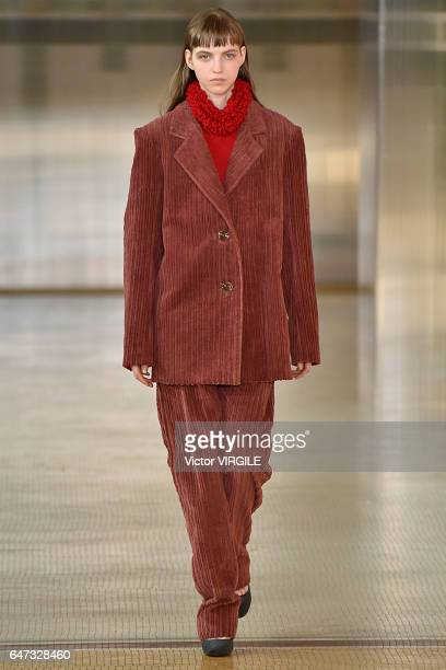 A model walks the runway during the Lemaire Ready to Wear fashion show as part of the Paris Fashion Week Womenswear Fall/Winter 2017/2018 on March 1...