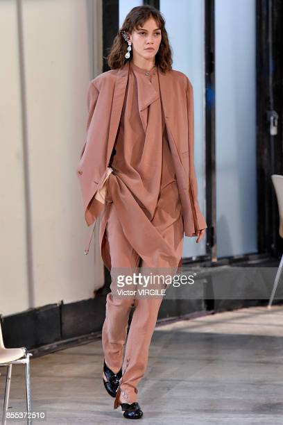 A model walks the runway during the Lemaire Ready to Wear Spring/Summer 2018 fashion show as part of the Paris Fashion Week Womenswear Spring/Summer...