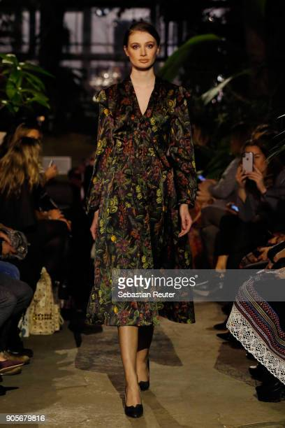 A model walks the runway during the Lena Hoschek Fashion Show Berlin at Botanischer Garten on January 16 2018 in Berlin Germany