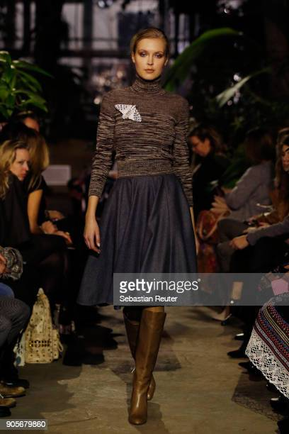 Model walks the runway during the Lena Hoschek Fashion Show Berlin at Botanischer Garten on January 16, 2018 in Berlin, Germany.