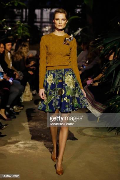 Model walks the runway during the Lena Hoschek Fashion Show Berlin at Botanischer Garten on January 16, 2018 in Berlin, Germany.