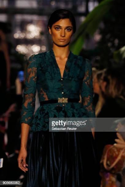 A model walks the runway during the Lena Hoschek Fashion Show Berlin at Botanischer Garten on January 16 2018 in Berlin Germany