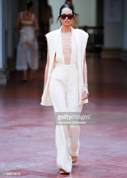 Model walks the runway during the Lenny Niemeyer fashion show during Sao Paulo Fashion Week N47 Summer 2020 at Pinacoteca on April 23, 2019 in Sao...