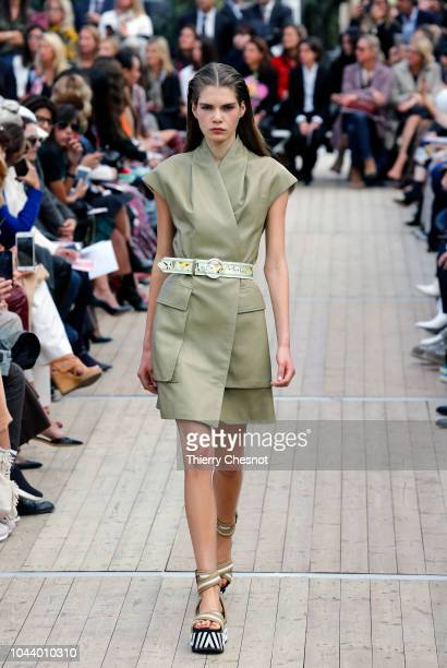 A model walks the runway during the Leonard Paris show as part of the Paris Fashion Week Womenswear Spring/Summer 2019 on October 1 2018 in Paris...