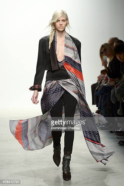 A model walks the runway during the Leonard Paris show as part of the Paris Fashion Week Womenswear Fall/Winter 20142015 on March 3 2014 in Paris...