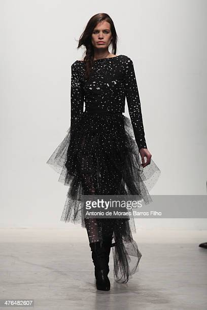 Model walks the runway during the Leonard Paris show as part of the Paris Fashion Week Womenswear Fall/Winter 2014-2015 on March 3, 2014 in Paris,...