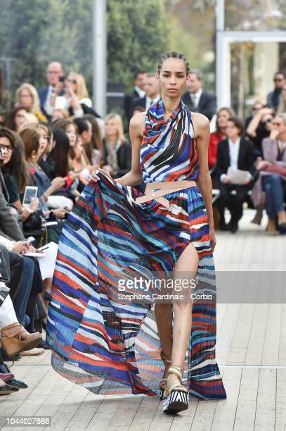 A model walks the runway during the Leonard show as part of the Paris Fashion Week Womenswear Spring/Summer 2019 on October 1 2018 in Paris France
