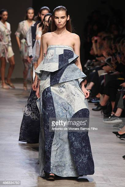 A model walks the runway during the Leonard show as part of the Paris Fashion Week Womenswear Spring/Summer 2015 on September 29 2014 in Paris France
