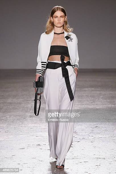 A model walks the runway during the Les Copains fashion show as part of Milan Fashion Week Spring/Summer 2016 on September 23 2015 in Milan Italy