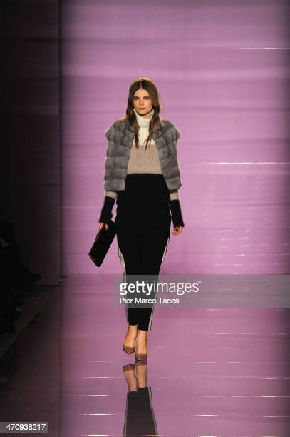 A model walks the runway during the Les Copains Show as part of Milan Fashion Week Womenswear Autumn/Winter 2014 on February 21 2014 in Milan Italy