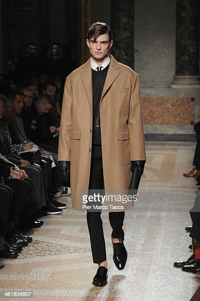 Model walks the runway during the Les Hommes show as a part of Milan Fashion Week Menswear Autumn/Winter 2014 on January 11, 2014 in Milan, Italy.