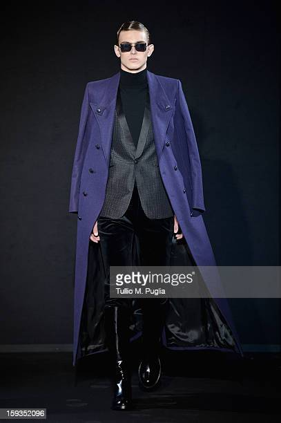 Model walks the runway during the Les Hommes show as part of Milan Fashion Week Menswear Autumn/Winter 2013 on January 12, 2013 in Milan, Italy.