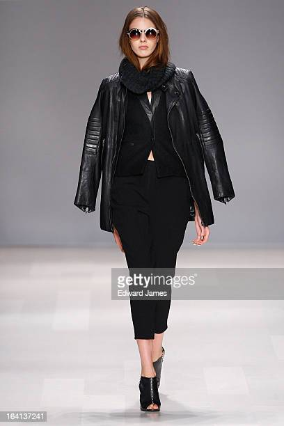A model walks the runway during the Line Knitwear fashion show at David Pecaut Square on March 19 2013 in Toronto Canada