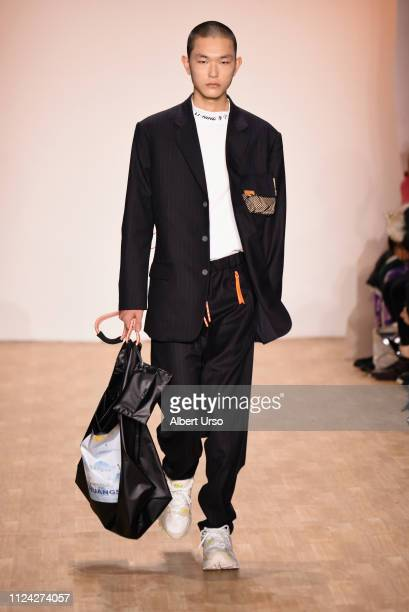 A model walks the runway during the LiNing Autumn/Winter 2019 Show during NYFW The Shows at Industria Studios on February 12 2019 in New York City