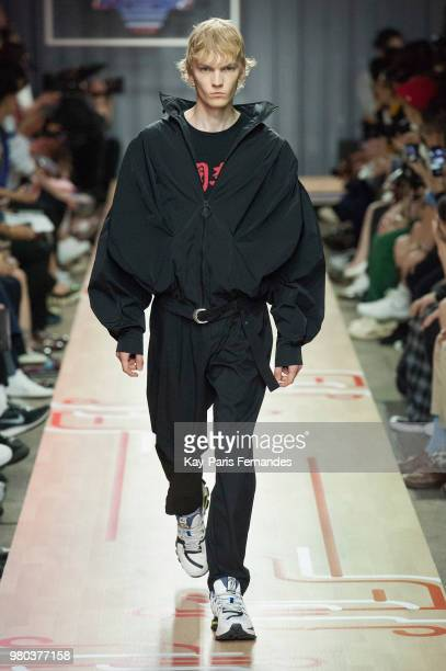 A model walks the runway during the LiNing Spring/Summer 2019 show as part of Paris Fashion Week at Les Nuits Fauves on June 21 2018 in Paris France