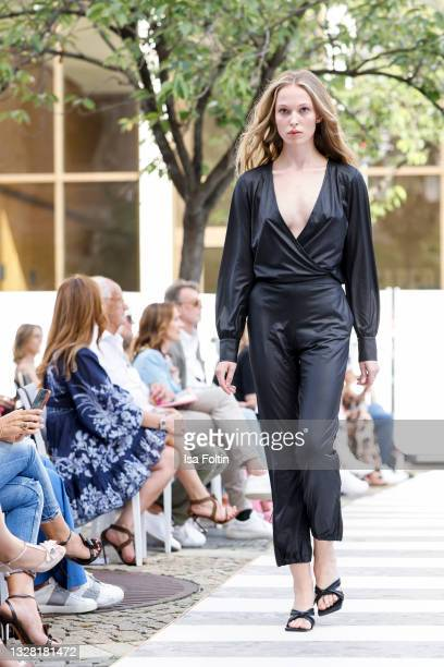 Model walks the runway during the Llobycats show as part of the first Frankfurt Fashion Week Spring/Summer 2022 at Open Air Runway Sofitel Frankfurt...