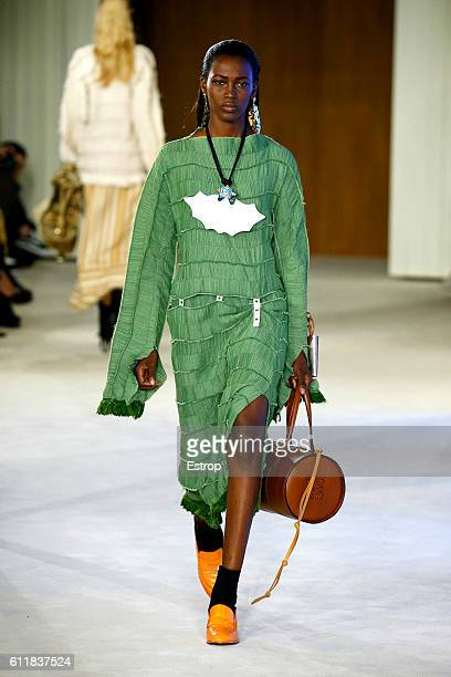 A model walks the runway during the Loewe designed by Stuart Vevers show as part of the Paris Fashion Week Womenswear Spring/Summer 2017 on September...