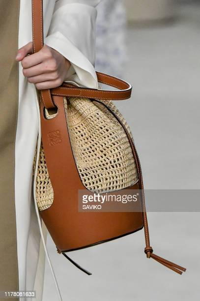Model walks the runway during the Loewe Ready to Wear Spring/Summer 2020 fashion show as part of Paris Fashion Week on September 27, 2019 in Paris,...