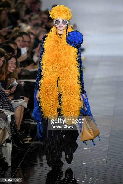 A model walks the runway during the Loewe show as part of the Paris Fashion Week Womenswear Fall/Winter 2019/2020 on March 1 2019 in Paris France