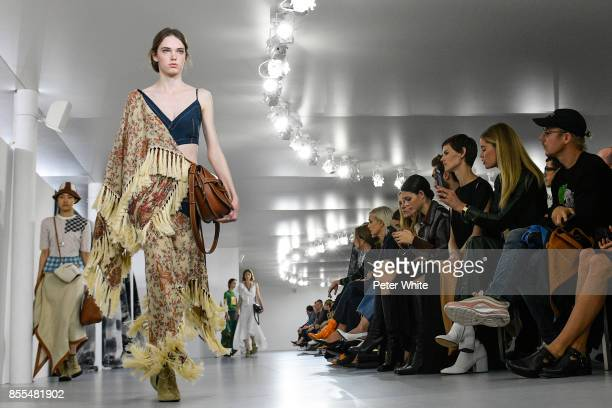 A model walks the runway during the Loewe show as part of the Paris Fashion Week Womenswear Spring/Summer 2018 on September 29 2017 in Paris France