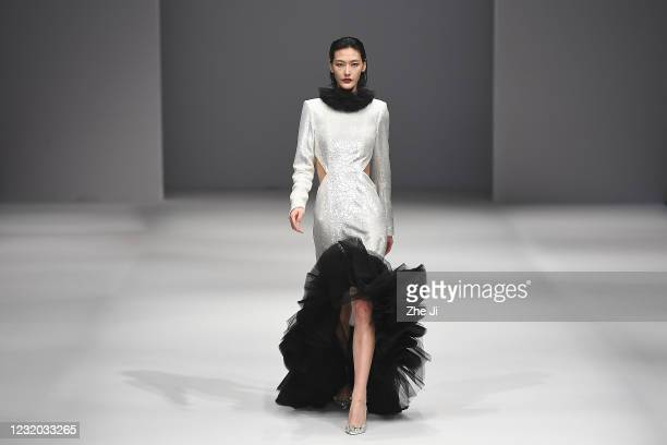 Model walks the runway during the LOORA PWD collection show by Loora on day eight of China Fashion Week A/W 2021/2022 at 751D.PARK on March 31, 2021...