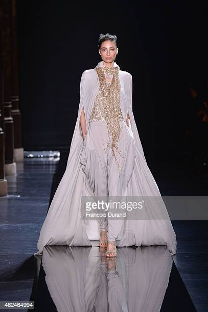 Model walks the runway during the Loris Azzaro show as part of Paris Fashion Week Haute Couture Spring/Summer 2015 on January 29, 2015 in Paris,...