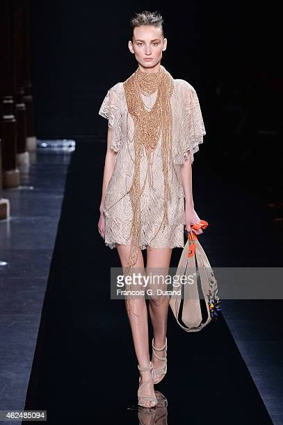 A model walks the runway during the Loris Azzaro show as part of Paris Fashion Week Haute Couture Spring/Summer 2015 on January 29 2015 in Paris...
