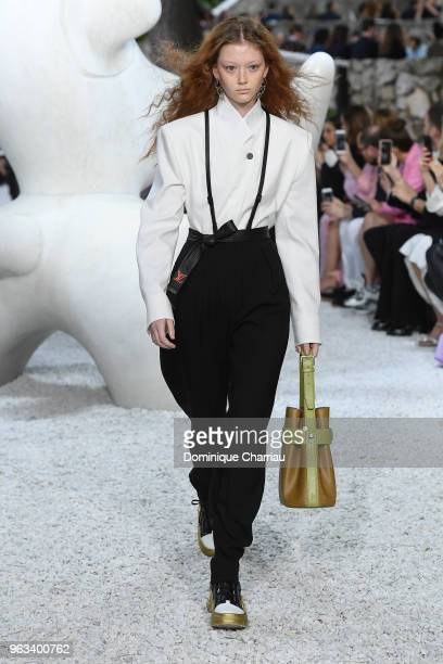 A model walks the runway during the Louis Vuitton 2019 Cruise Collection at Fondation Maeght on May 28 2018 in SaintPaulDeVence France