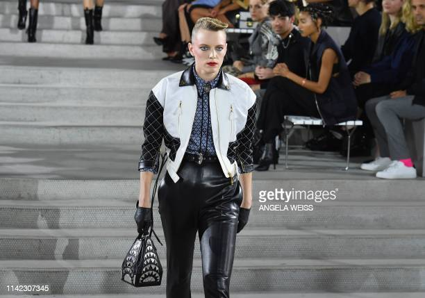 A model walks the runway during the Louis Vuitton Cruise 2020 Fashion Show at TWA Flight Center at JFK Airport on May 8 2019 in New York City