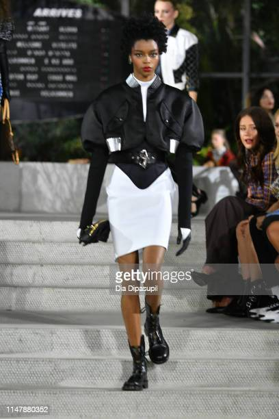 Model walks the runway during the Louis Vuitton Cruise 2020 Fashion Show at JFK Airport on May 08, 2019 in New York City.