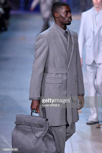 Model walks the runway during the Louis Vuitton Menswear Fall/Winter 2019-2020 fashion show as part of Paris Fashion Week on January 17, 2019 in...