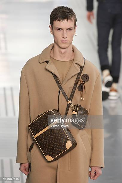 A model walks the runway during the Louis Vuitton Menswear Fall/Winter 20152016 show as part of Paris Fashion Week on January 22 2015 in Paris France