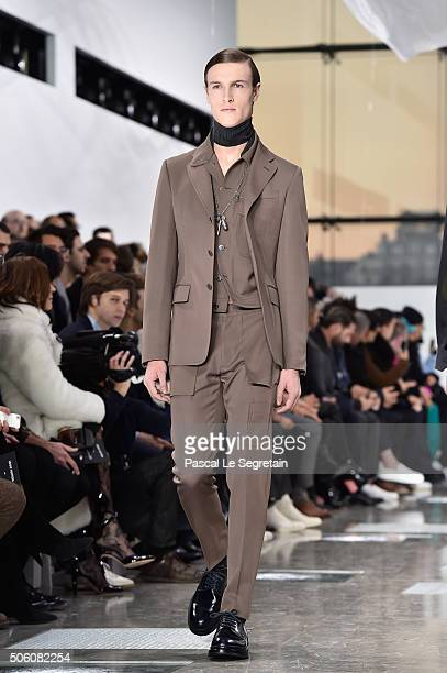 A model walks the runway during the Louis Vuitton Menswear Fall/Winter 20162017 show as part of Paris Fashion Week on January 21 2016 in Paris France