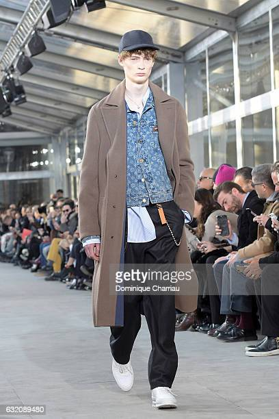 A model walks the runway during the Louis Vuitton Menswear Fall/Winter 20172018 show as part of Paris Fashion Week on January 19 2017 in Paris France