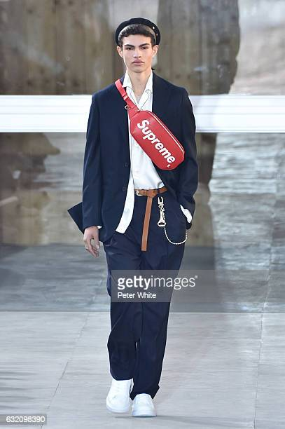 Model walks the runway during the Louis Vuitton Menswear Fall/Winter 2017-2018 show as part of Paris Fashion Week on January 19, 2017 in Paris,...