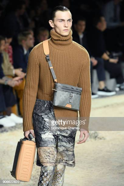 A model walks the runway during the Louis Vuitton Menswear Fall/Winter 20182019 show as part of Paris Fashion Week on January 18 2018 in Paris France