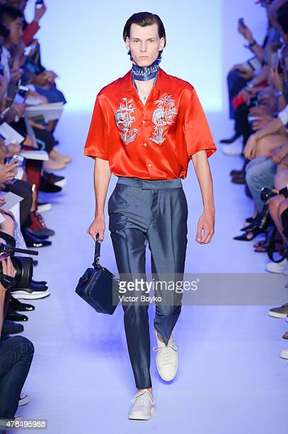 A model walks the runway during the Louis Vuitton Menswear Spring/Summer 2016 show as part of Paris Fashion Week on June 25 2015 in Paris France