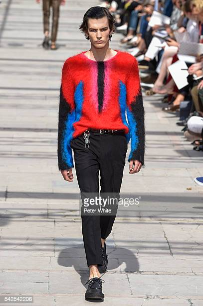 A model walks the runway during the Louis Vuitton Menswear Spring/Summer 2017 show as part of Paris Fashion Week on June 23 2016 in Paris France