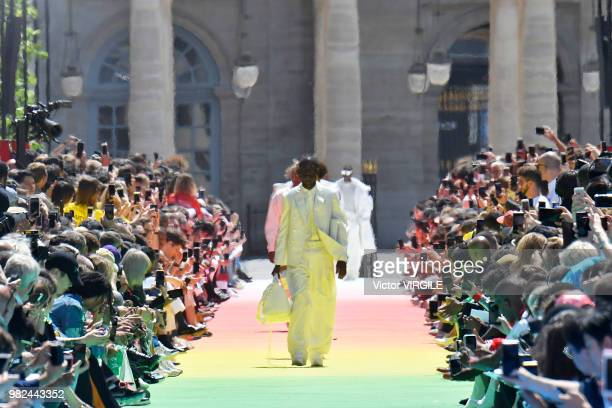A model walks the runway during the Louis Vuitton Menswear Spring/Summer 2019 fashion show as part of Paris Fashion Week on June 21 2018 in Paris...
