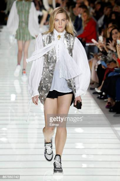 A model walks the runway during the Louis Vuitton Paris show as part of the Paris Fashion Week Womenswear Spring/Summer 2018 on October 3 2017 in...
