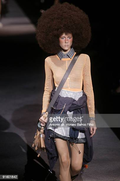 Model walks the runway during the Louis Vuitton Pret a Porter show as part of the Paris Womenswear Fashion Week Spring/Summer 2010 at Cour Carree du...