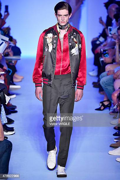 A model walks the runway during the Louis Vuitton Ready to Wear Menswear Spring/Summer 2016 show as part of Paris Fashion Week on June 25 2015 in...